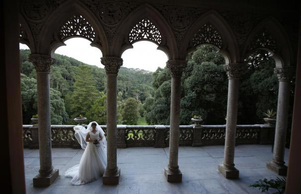 A woman wearing a wedding dress is photographed at Monserrate Palace in Sintra